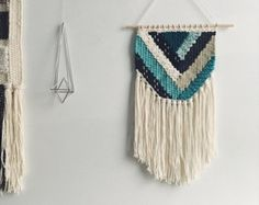 This is a hand woven wall hanging in a palette of creamy neutrals. The ends of the fringe are dip-dyed to a dark grey. Id be happy to dye the fringe any color youd like, just shoot me a note!  The dowel is 24 inches wide, and the whole weaving measures 24x28 inches, including the fringe.   It makes a beautiful gift for a housewarming, birthday, or wedding.   This weaving is made to order (~2 weeks) and comes with the dowel, ready to hang. Made by hand on a frame loom.   Please contact me…