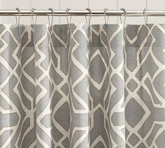 Neutral gray shower curtain that can be paired with many accent colors in bath accessories
