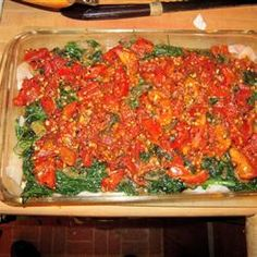 This delicious baked haddock is prepared with spinach and diced tomatoes, then smothered in a rich, tangy tomato sauce. Spinach Bake, Spinach Recipes, Fish Recipes, Seafood Recipes, Cooking Recipes, Healthy Recipes, Frozen Spinach, Lunch Recipes, Healthy Meals