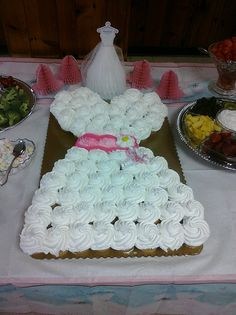 Cute cake for a shower - make a wedding dress out of cupcakes!