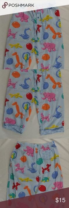 "Nick & Nora Balloon Animal PJ Cropped Pants M Nick and Nora Balloon Animal Pajama Lounge Cropped Pants Medium. Elastic Waistband with ties to adjust waist, thin breathable material. Item is pre owned but in very good conditions, no rips or stains, item comes from smoke free home.? Material: 100% cotton? Measurements:? Waist: 15"" (on flat surface) can stretch another 1-2 inches with elastic waistband? Inseam: 21""? Rise: 12""? nick & nora Intimates & Sleepwear Pajamas"