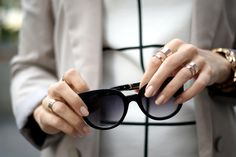 Black sunglasses & golden rings / details