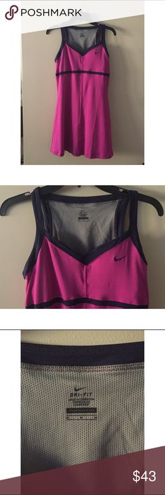"""Nike Dri-Fit Fuchsia Navy Border Tennis Dress NWOT Style: 405190-681 Fabric: 88% Polyester & 12% Spandex  Colors: Fuchsia Navy  Dri-Fit pulls sweat away to help keep you dry and comfortable.  Built in mesh bra with molded cups.  V-neck front.  Sleeveless.  Navy blue band under bust area that goes all the way around to the back.  ARMPIT TO ARMPIT: 16""""  *note: this measurement was taken with the item laying flat and only measured across the front, not all the way around*  LENGTH: 30 1/2"""" Nike…"""