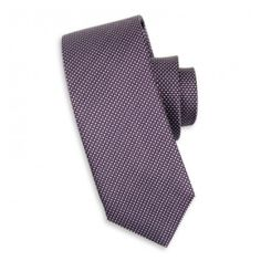 This purple silk tie can be worn for any occasion and looks great with a white shirt.