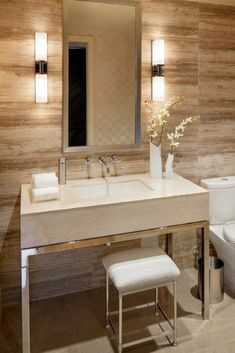 Use wall-mounted lighting on both sides of the mirror to give an even light to your face, which is also great for makeup application. [Wall Mounted Lighting, Bathroom Ideas, Bathroom Design, Bathroom Sit Down Vanity, Large Mirror, Wall Lights, Tile Wall, Bathroom Sink Ideas]