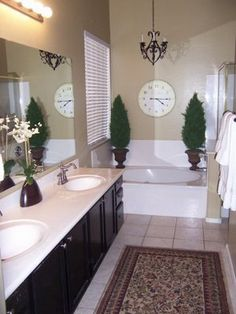 Bathroom. I like the white with the taupe walls, the black vanity