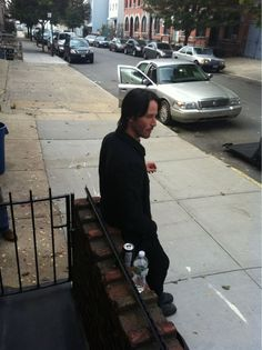 "This is a photo of Keanu Reeves smoking a cigarette outside of my apartment. We briefly conversed. I said ""Hey bro, loved you in Point Break."" He said ""Thanks, bro."" I walked upstairs.        - I'm soooo jealous!!!!"