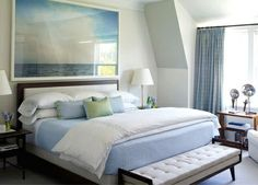 30 Beautiful Coastal Beach Bedrooms - artwork over the bed, photograph by Marine Hugonnier