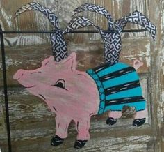 Mr. Piggy would look adorable in any yard with his striped swim trunks! Dimensions: 14 in. Width 14 in. Length