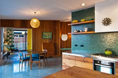Nelson House – Cedar cladding extends inside giving the house a 70s feel. The kitchen is macrocarpa