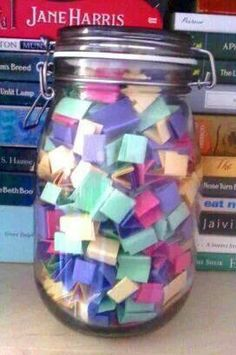 I love this idea - write down book titles you want to read on a small piece of paper fold it up and put it in a jar. Book lucky dip.