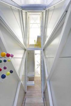 Last week, we got the news that Polish architect Jakub Szczesny completed the Keret House — also known as the world's skinniest house — as an art installation for writer Etgar Keret. This week, we finally have pictures of the interior! Houses In Poland, Narrow House Designs, Blog Design Inspiration, Interior Architecture, Interior Design, Florence Knoll, Unusual Homes, Compact Living, Tiny Spaces