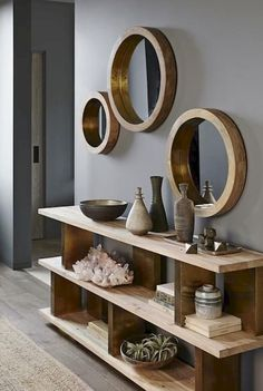 Round mirrors are held by thick wooden frames that evoke the glamour of a luxury liner. Shiny brass trim on the inner rim accentuates the clean and simple design. Made of mango wood with a waxed finish. x deep Medium dia. Decoration Hall, Entryway Decor, Entryway Mirror, Tv Decor, Ikea Mirror, Mirror Wall Decorations, Modern Entryway, Table Mirror, Wood Home Decor