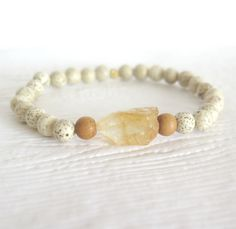 Citrine Bracelet / Abundance Bracelet / Lotus Seed Yoga Bracelet / Raw Citrine Nugget / Boho Chic Stacking Bracelet / Eco Friendly Jewelry by theblackstarboutique on Etsy https://www.etsy.com/listing/264044959/citrine-bracelet-abundance-bracelet