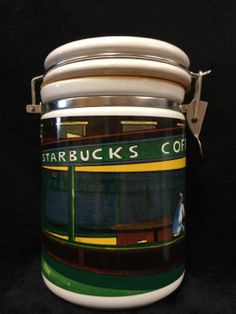 WONDERFUL STARBUCKS CERAMIC COFFEE CANISTER. FEATURES A THROWBACK SHOT TO ONE OF THEIR EARLY COFFEE BARS. NICE COLLECTIBLE CONDITION. 8H X 6W