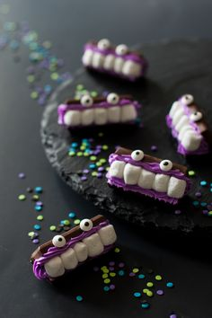 "These Bite-Size Marshmallow Monsters by Handmade Charlotte are a perfect ""BITE"" sized snack this Halloween. Add this to your party and it's sure to be a 'monster' favorite!"
