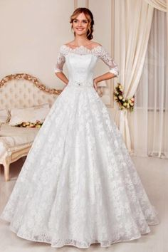 This exquisite English-style wedding gown breathes with royal chic.  The delicate lace overlay covering this dress from head to toe adds a romantic touch, and the short corset with a bateau neckline highlights your figure in all the right places. The voluminous skirt with a train is luxurious yet light, and the trail of imitation pearls on the back of the dress is ever so alluring.  In a dress like this, you won't need a crown to be a queen.  *The price doesn't include acce...