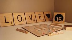 he proposed with a scrabble board... cute theme? maybe table numbers?