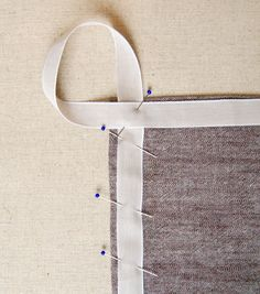 DIY  Simple Dishtowels - the purl bee.   I think I want to do this to my bath towels - much easier to hang!