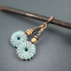 sea urchin earrings • tribal • rustic earrings • blue patina • raw glass beads • verdigris • disc earrings • hand made jewelry • primitive by entre2et7 on Etsy