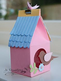 DIY cardboard bird house and other crafts.