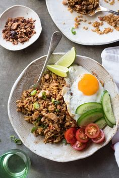 Nasi Goreng - Traditional Indonesian fried rice, full of flavour, easy to make and no hunting down unusual ingredients! Nasi Goreng is the popular Indonesian fried rice which is traditionally served with a fried egg. Rice Recipes, Asian Recipes, Cooking Recipes, Healthy Recipes, Ethnic Recipes, Thai Cooking, Indonesian Fried Rice Recipe, Indonesian Recipes, Fried Rice Dishes
