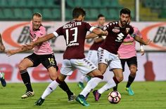 Luca Rossettini (C) and Marco Benassi (R) of Torino hold off the challange from Oscar Hiljemark of Palermo during the Serie A match between US Citta di Palermo and FC Torino at Stadio Renzo Barbera on October 17, 2016 in Palermo, Italy.