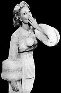 Dinah Shore in her classic 'throwing-a-kiss' pose which often came at the end of her 'See-The-USA' song on her 1950s TV show.