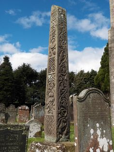 """""""The Bewcastle Cross is an Anglo-Saxon cross which is still in its original position within the churchyard of St Cuthbert's church at Bewcastle, in the English county of Cumbria. The cross, which probably dates from the 7th or early 8th century, features reliefs and inscriptions in the runic alphabet. The head of the cross is missing but the remains are 14.5 feet (4.4 metres) high, and almost square in section (56 x 54 cm at the base). """""""