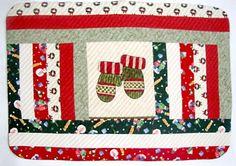 Peça de jogo americano com tema de natal em patchwork e quilt
