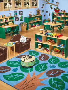This classroom is set up amazingly well. You can see that it is themed, without being frumpy. It is cohesive, yet divided. Each area has its own space. You can easily see that the music area is just the music area. A well set up classroom will have minimal open space to discourage running/rough/'outside' play. Kudoos to this set up!