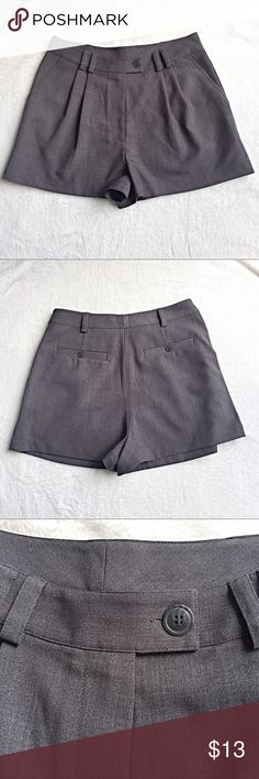 Fossil gray dressy pleated shorts. Size 27 Fossil gray dressy pleated shorts. Size 27.. 63% polyester, 33% viscose, 3% spandex.  Inseam 2 1/4. Rise 12. Front side pockets. Back buttoned slit pockets Fossil Shorts