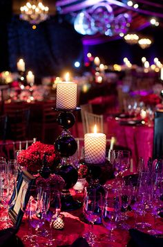 Decorated candles and eye-catching candle sticks make for an elegant setting. #WeddingCenterpiece