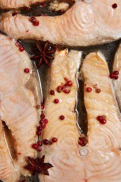 Wine-Poached Salmon Steaks. This weeknight-friendly salmon recipe is sure to be a new family favorite! Poaching the salmon ensures that it won't dry out and it makes cooking SO EASY. You'll need salmon steaks, dry Riesling or Sauvignon Blanc, anise pods, {pink} peppercorns, and cilantro.