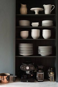 country style | deVOL kitchen // amazing dark greyish green shaker style kitchen with sculptural elements // white ceramics on display
