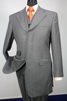 This Solo 360 men's 3 piece solid fashion suit comes in luxurious super 150's 100% wool fabric. The 3 hidden button jacket in a 34 inch fashion length includes a notch lapel, back flap, back belt and side vents. The matching 4 button vest includes a notch lapel and comes fully lined. The entire fashion suit comes complete with wide leg pants lined to the knee with 22 inch bottoms.