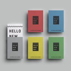 """""""HELLO NEW DAY""""はお好みのペーパーケースに入って手元に届きます。  グレー、レッド、ブルー、イエロー、グリーンの5色です。"""