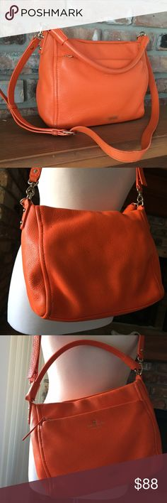 Kate Spade Orange Leather Shoulder-bag This is a very pretty hand/shoulder bag. Soft leather with inside and outside pockets. Double strap for hand and shoulder. Zipper feature w large pocket outside. Gold hardware. Has a rubbed out stain on front which is noticeable. However if you can spot cover with a bit of orange chalk paint or leather cover you're in for a really nice bag! Modest wear nothing else as noticeable. Great buy! kate spade Bags Shoulder Bags