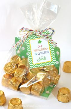Our Friendship is Golden Favors in clear cello with baker's twine.  http://www.nashvillewraps.com/ribbon/bakers-twine/c-024593.html
