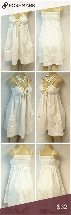"""40% BUNDLE DISCOUNT! FREE SHIPPING ON BUNDLES!! ONEILL, Sundress, size Large See Measurements, embroidery sprinkled throughout, pintuck at hem, patch pockets, elastic under bust, lined, lightweight soft material, machine washable, 100% cotton, approximate measurements: 35"""" length, 15"""" bust laying flat but stretches to 18"""" comfortably plus adjustable self-tie bust/straps. ADD TO A BUNDLE!?? 40% BUNDLE DISCOUNT! FREE SHIPPING ON BUNDLES!! ?OFFER? 40% less Plus $6 LESS ON BUNDLES for shipping…"""