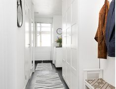 huge wardrobes in the hallway, floor, carpets, mirror, bench. everything in white - only floor is black♥