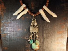 This Earthy Rustic Tribal Bold Warrior Princess Statement necklace- Turquoise Turtle Clan features a center piece of tribal silver with