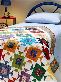 Mosaic Memories- I designed and made this quilt for a HOWB Book the year????  I just gave to my son and daughter in law for the baby their new baby that wil be here in June!  Jill Reber