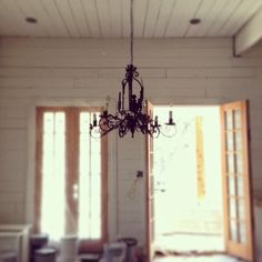 """Joanna Gaines used Sherwin Williams """"Alabaster"""" for her white shiplap walls"""
