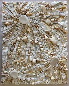 "Ely Robertson-Briggs has finished her ""working in white"" - mosaic tile and shells."