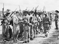 Men of the 25th Indian Division at Kuala Lumpur search Japanese prisoners soon after they had been disarmed.