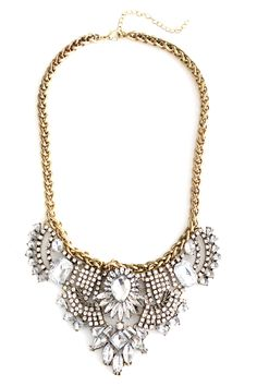 Time to put it on ice. This necklace is a modern take on Victorian jewelry. It features glass crystals in all different cuts, all clustered together to form this day-to-night elegant bib. Wear it over a LBD to add contrast.Item Details:Length: 20