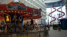 B-roll footage of Boardwalk onboard Harmony of the Seas. Boardwalk is an area for the entire family, whether young or just young at heart, to enjoy together. The elements of the Boardwalk are a dynamic way to engage families in classic fun with a colorful original carousel as well as casual eateries, retail outlets and carnival games.