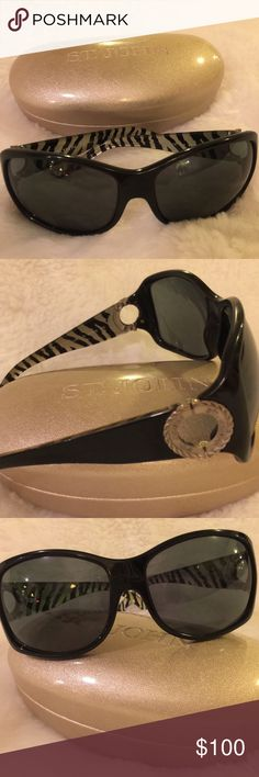 St.John black,zebra striped eyewear/sunglasses. Classic St.John eyewear. Black. Made in Italy. Zebra design embedded in inside of arms. Metallic peep hole detail at temples. Very slight pitting on one arm. St. John Accessories Glasses