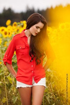 Christina : Sunflowers I - Model Christina wearing denim shorts and a red shirt in a sunflower field
